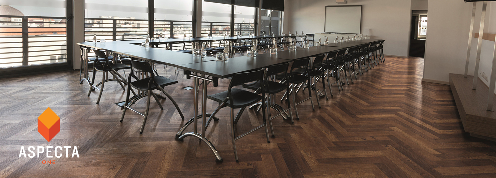 Room with large table and chairs with Shipwright Roseway floors